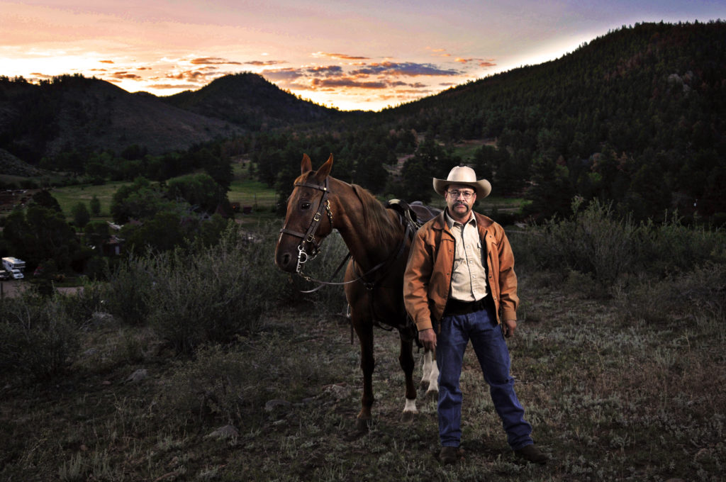 Photographer and Cowboy Jeff Julian poses for a portrait at Cherokee Park Ranch in Livermore, Colorado, July 17, 2012.